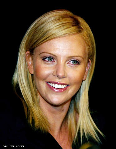 charlize theron height weight